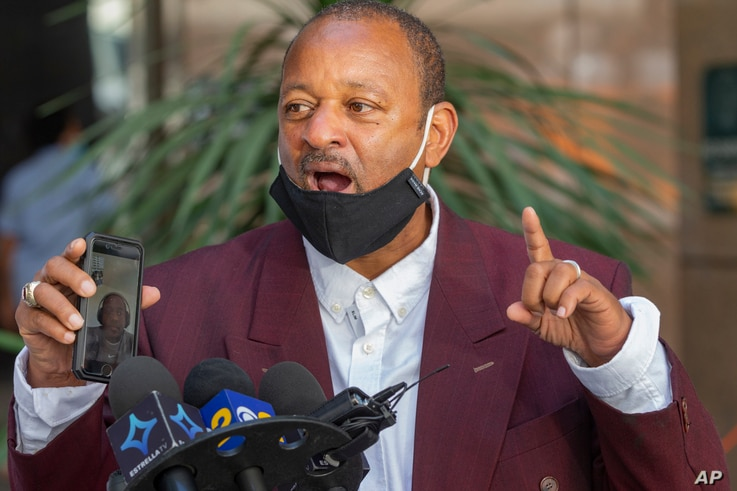 Activist Najee Ali speaks as he was calling for an independent investigation in the deaths of both Robert Fuller and Malcolm…