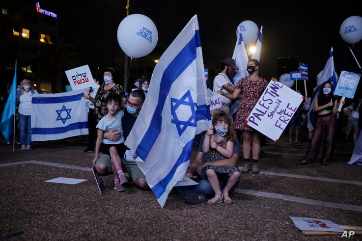 People take part in a protest against Israel's plan to annex parts of the West Bank and Trump's mideast initiative, in Tel Aviv…