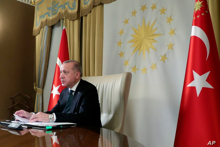 Turkish President Recep Tayyip Erdogan participates in a teleconference with European leaders, in Istanbul, Tuesday, March 17,…