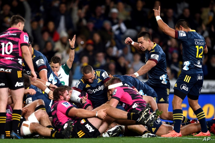 The Highlanders celebrate after scoring their first try during the Super Rugby Aotearoa rugby game between the Highlanders and…