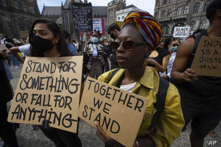 People take part in a Black Lives Matter protest in Amsterdam, Netherlands, Monday, June 1, 2020, to protest against the recent…