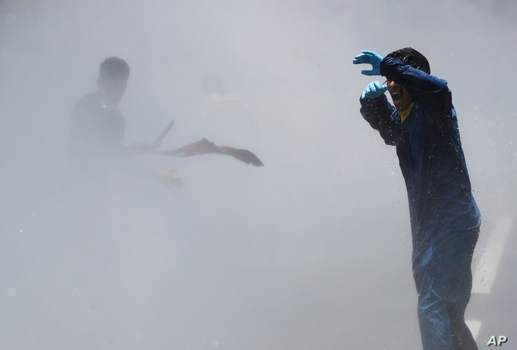 Nepalese police use water cannon to disperse youth who gathered for a protest near prime minister's residence demanding better…