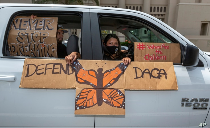 An immigrant family joins members of Coalition for Humane Immigrant Rights of Los Angeles, CHIRLA, on a vehicle caravan rally…