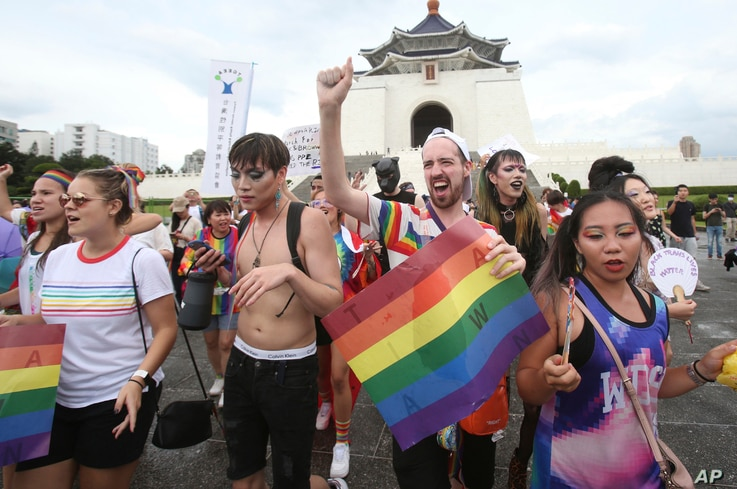 "Participants march during the ""Taiwan Pride March for the World!"" at Liberty Square at the CKS Memorial Hall in Taipei, Taiwan,…"
