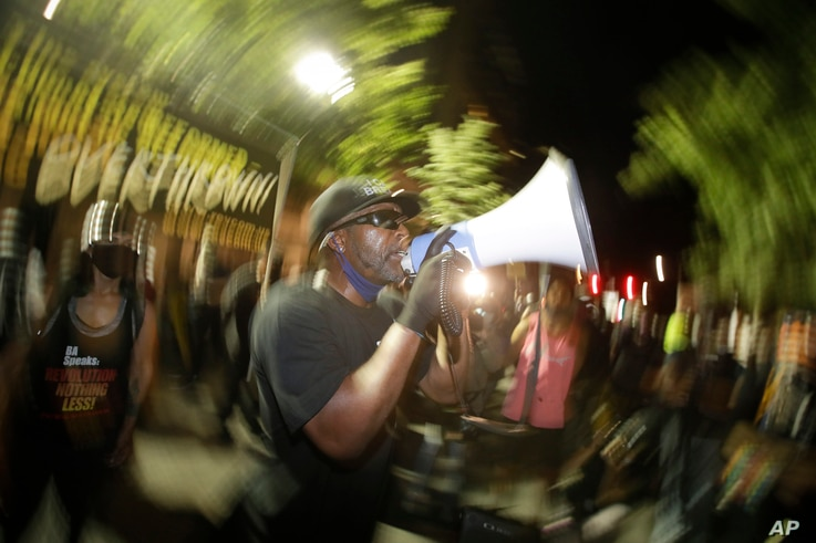 A speaker addresses the crowd during a Black Lives Matter protest at the Mark O. Hatfield United States Courthouse Thursday,…