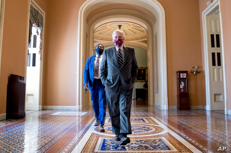 Senate Majority Leader Mitch McConnell of Ky., walks off the Senate floor on Capitol Hill in Washington, Wednesday, July 29,…
