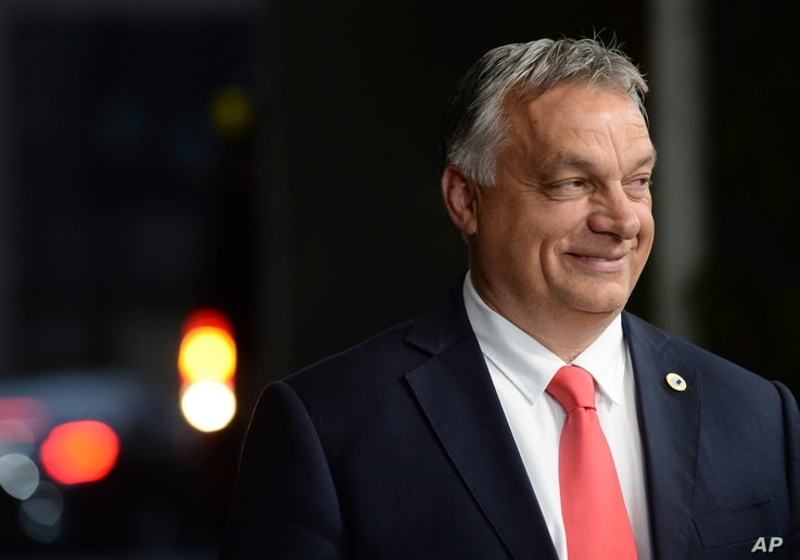 Hungary's Prime Minister Viktor Orban leaves the EU Council building early in the morning during an EU summit in Brussels,...