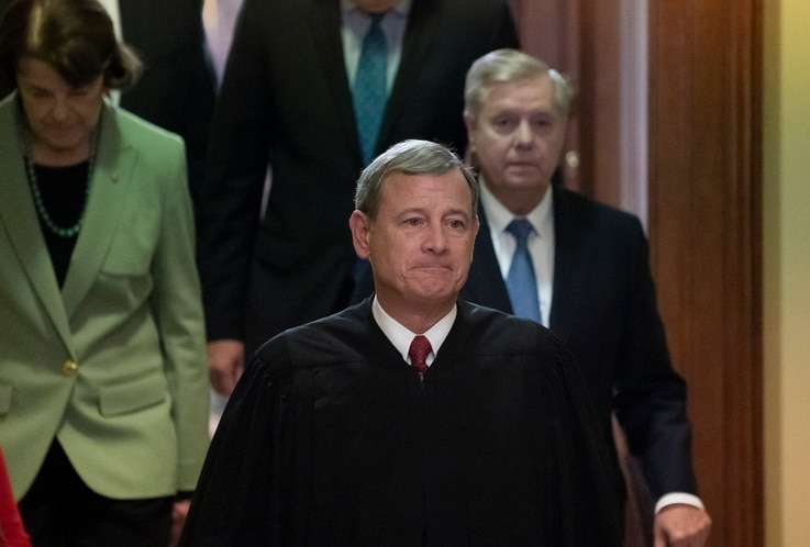 Chief Justice John Roberts, followed by Sen. Dianne Feinstein, D-Calif., left, and Senate Judiciary Committee Chairman Lindsey...