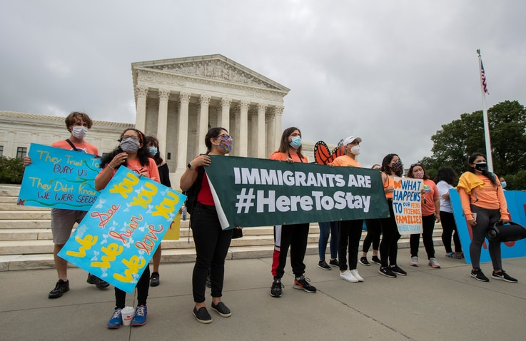 In this June 18, 2020, photo, Deferred Action for Childhood Arrivals (DACA) students celebrate in front of the Supreme Court...