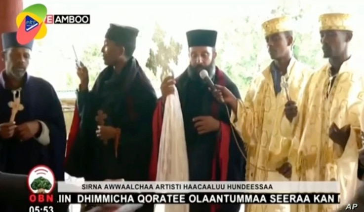 In this image taken from OBN video, the funeral for Ethiopia singer Hachalu Hundessa takes place in Ambo, Ethiopia, Thursday…