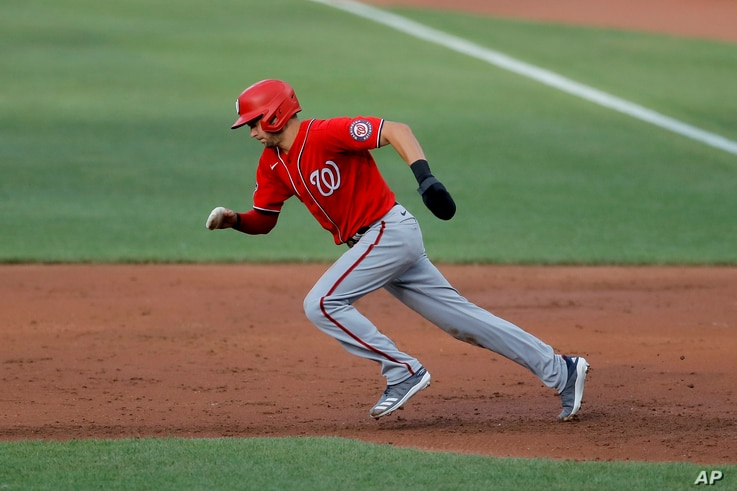 Washington Nationals' Trea Turner tries to steal second base against the Baltimore Orioles during an exhibition baseball game,…