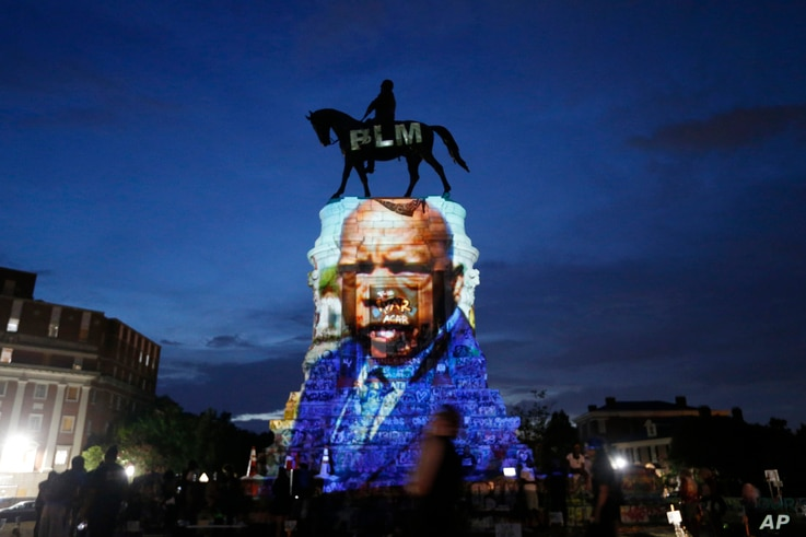 An image of the late Georgia Congressman and civil rights pioneer U.S. Rep. John Lewis is projected on to the pedestal of the...