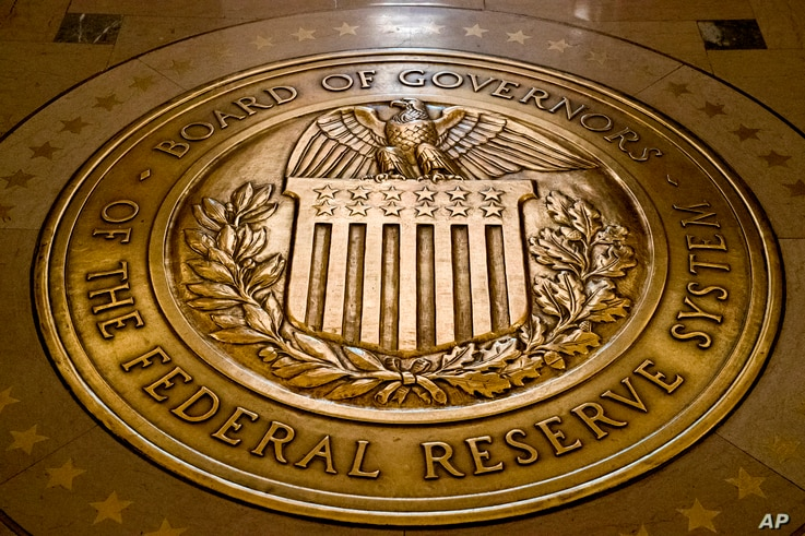 FILE - This Feb. 5, 2018, file photo shows the seal of the Board of Governors of the United States Federal Reserve System at…