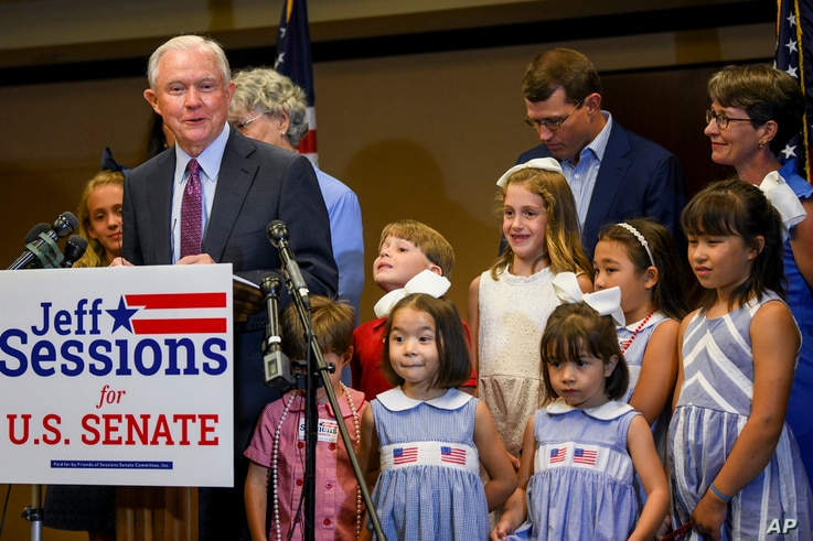 Former U.S. Attorney General Jeff Sessions, joined by family members, delivers his concession speech Tuesday, July 14, 2020, in…