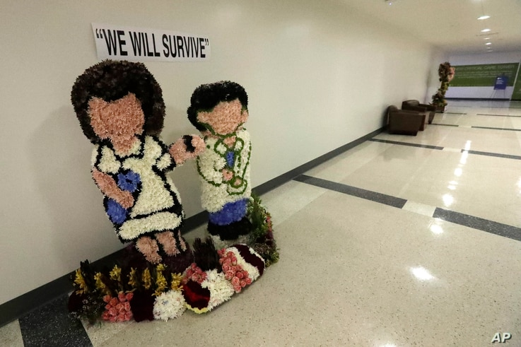 A flower arrangement is shown at Jackson Memorial Hospital, Monday, July 13, 2020, in Miami. Florida's rapidly increasing…