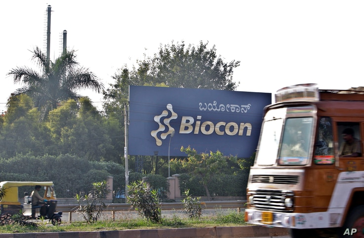 Traffic moves outside the main premises of Biocon, an Indian biotech company, in Bangalore, India, Friday, Dec. 17, 2010. U.S…