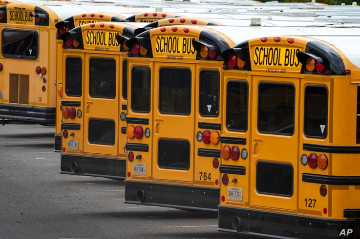 Fairfax County Public School buses are lined up at a maintenance facility in Lorton, Va., Friday, July 24, 2020. The nation's…
