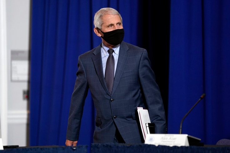 Dr. Anthony Fauci, director of the National Institute of Allergy and Infectious Diseases arrives to participate in a roundtable…