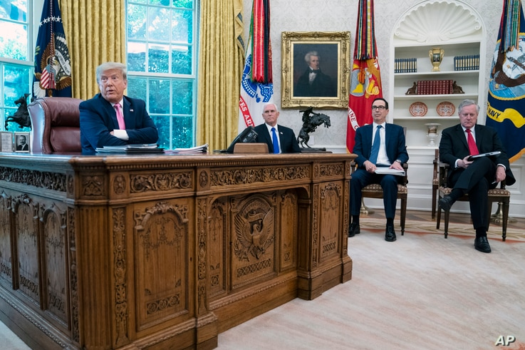 President Donald Trump speaks during a meeting with Senate Majority Leader Mitch McConnell of Ky., and House Minority Leader…