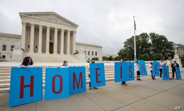 FILE - In this June 18, 2020, file photo, Deferred Action for Childhood Arrivals (DACA) students gather in front of the Supreme…