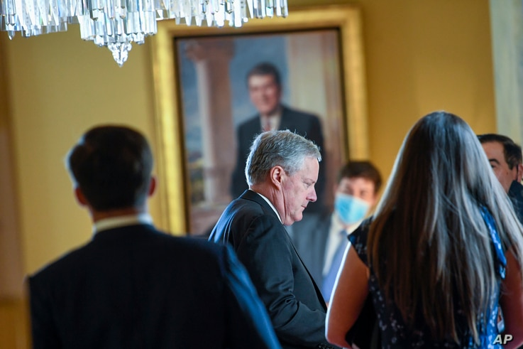 White House Chief of Staff Mark Meadows, center, waits in the office of Senate Majority Leader Mitch McConnell of Ky., on…
