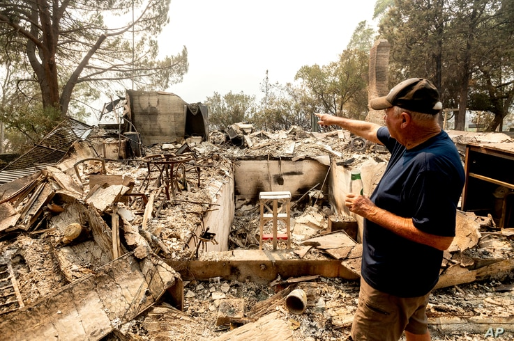 Hank Hanson, 81, gestures to the kitchen of his home, destroyed by the LNU Lightning Complex fires, in Vacaville, Calif., on…