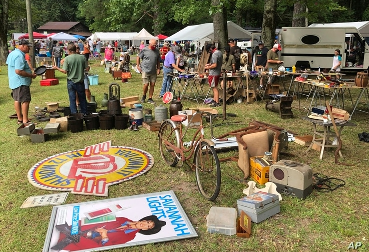 A crowd looks through items at the World's Longest Yard Sale, which stretches from Alabama to Michigan, at its southernmost…