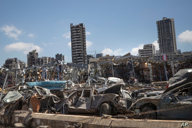 Damaged cars remain at the site of the Aug. 4 deadly blast in the port of Beirut that killed scores and wounded thousands, in…
