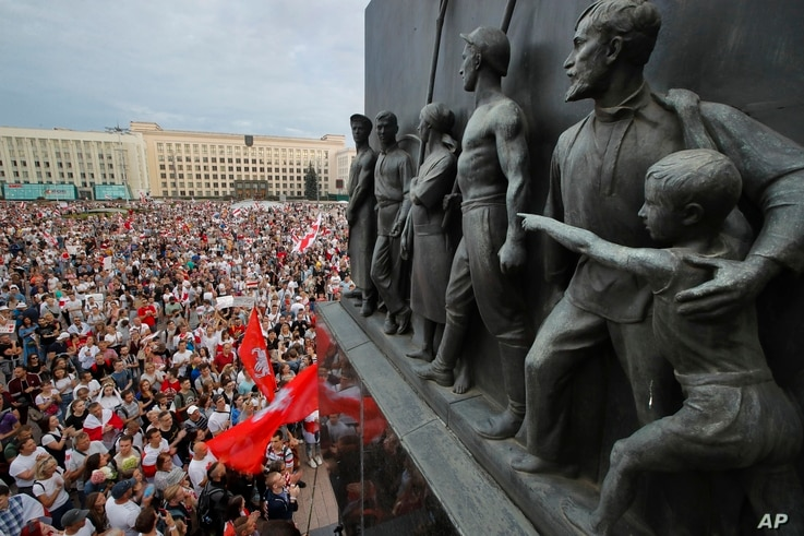 FILE - In this Tuesday, Aug. 18, 2020 file photo Belarusian opposition supporters gather for a protest rally in front of the…