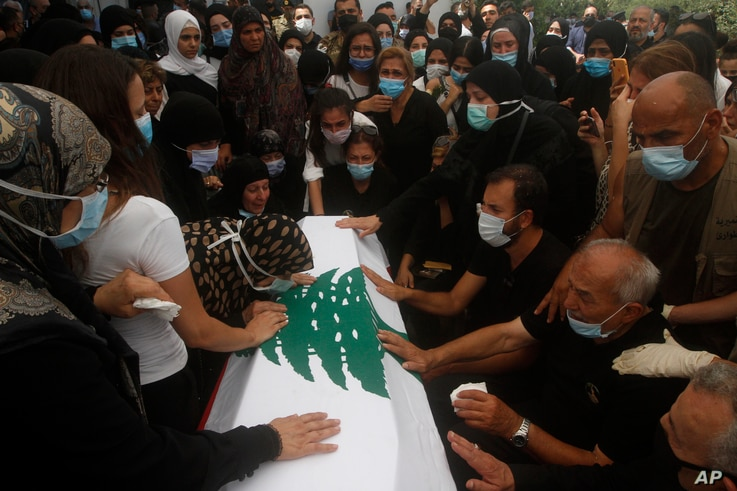 Relatives of Lebanese army lieutenant Ayman Noureddine, who was killed by Tuesday's explosion that hit the seaport of Beirut,…