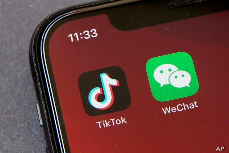 Icons for the smartphone apps TikTok and WeChat are seen on a smartphone screen in Beijing, Friday, Aug. 7, 2020. President…