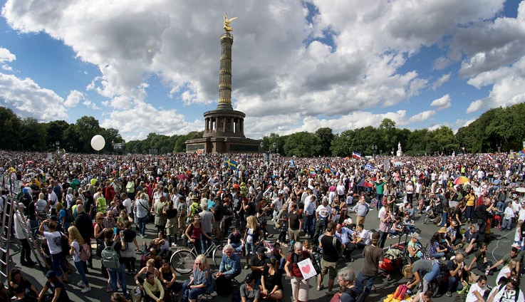 People gather at the Victory Column as they attend a protest rally in Berlin, Germany, Saturday, Aug. 29, 2020 against new…