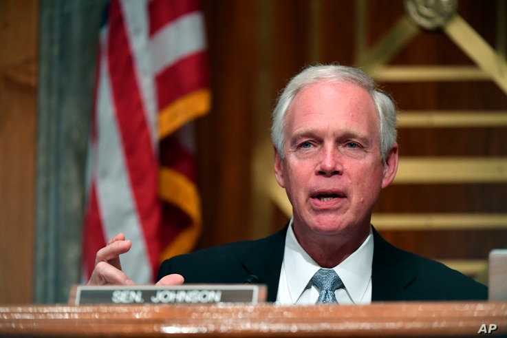 FILE - In this Aug. 6, 2020, file photo, Sen. Ron Johnson, R-Wis., speaks during a Senate Homeland Security and Governmental…