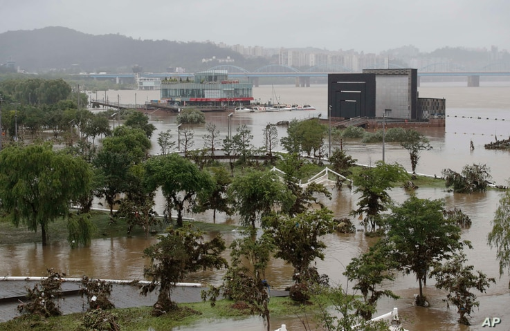 A part of a park near the Han River are flooded due to heavy rain in Seoul, South Korea, Sunday, Aug. 9, 2020. The safety…