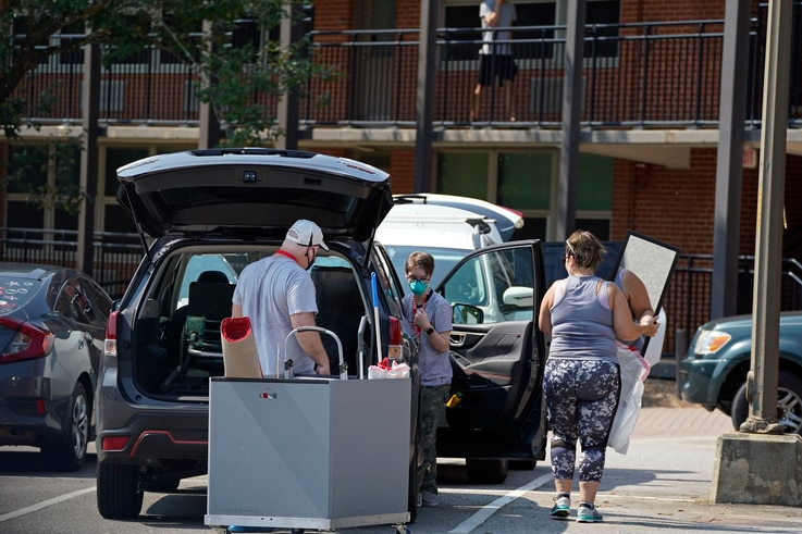 Students and parents begin to move student's belongings out of Bragaw Hall at North Carolina State University in Raleigh, N.C.,…