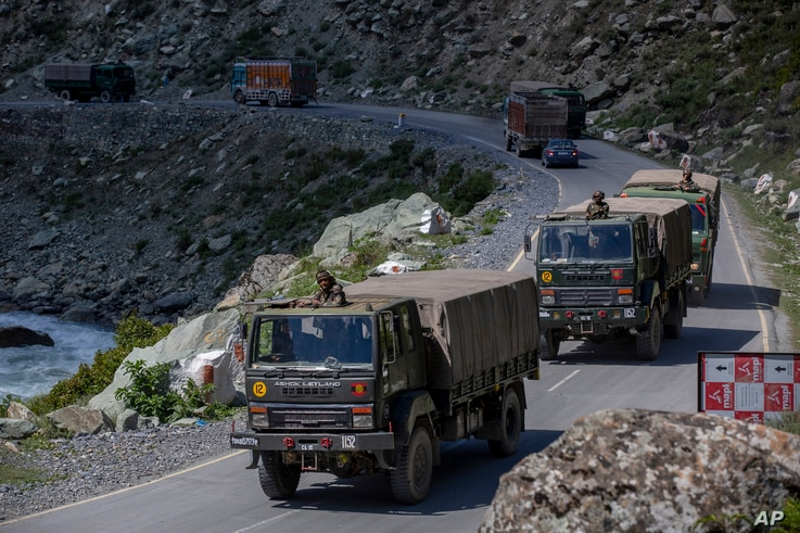 An Indian army convoy moves on the Srinagar- Ladakh highway at Gagangeer, northeast of Srinagar, Indian-controlled Kashmir,…