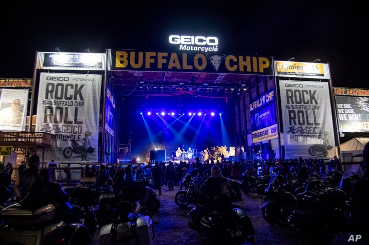 Motorcycles are parked in the audience during The Reverend Horton Heat's performance on the Wolfman Jack Stage at Buffalo Chip…