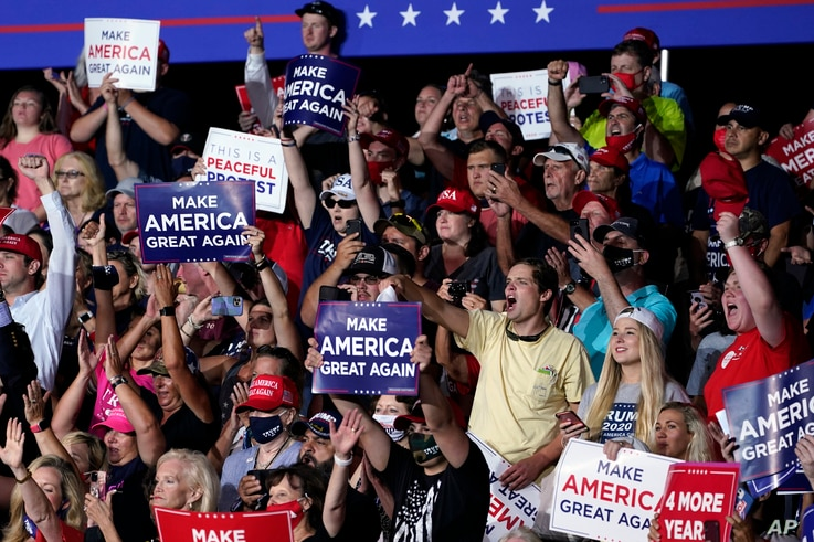 Supporters cheer as President Donald Trump speaks during a campaign rally at Smith Reynolds Airport, Tuesday, Sept. 8, 2020, in…