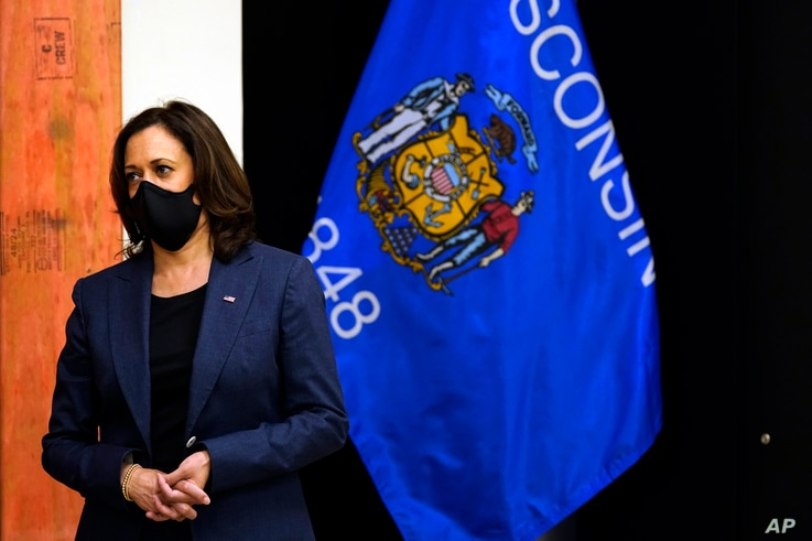 Democratic vice presidential candidate Sen. Kamala Harris, D-Calif., listens during a tour of the IBEW 494 training facility…