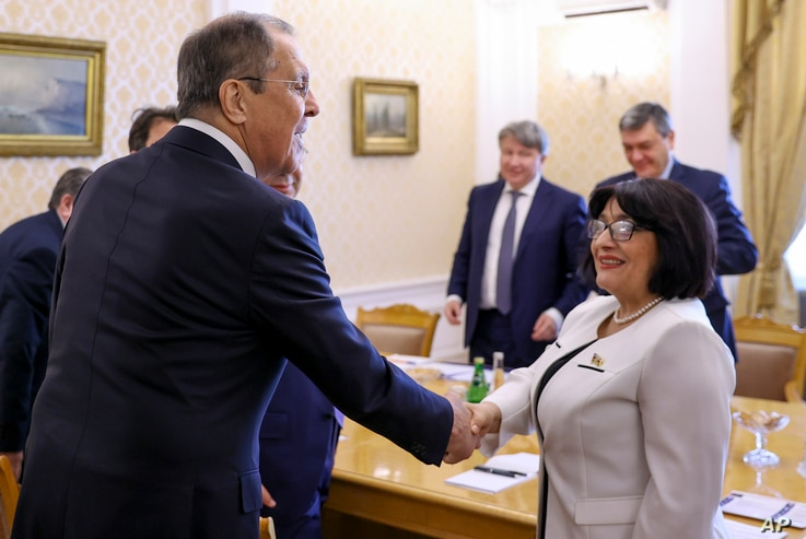In this photo released by Russian Foreign Ministry Press Service, Russian Foreign Minister Sergey Lavrov, left, greets Sahiba…