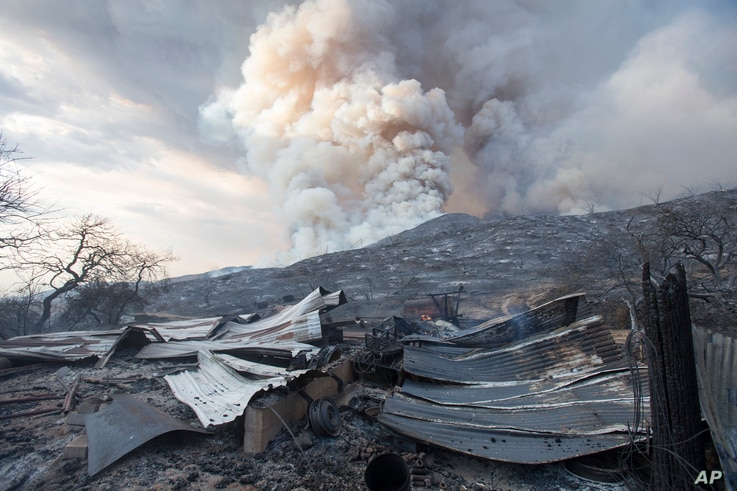 FILE - In this Saturday, Sept. 5, 2020, file photo, a burned structure is seen at a wildfire in Yucaipa, Calif. A couple's plan…