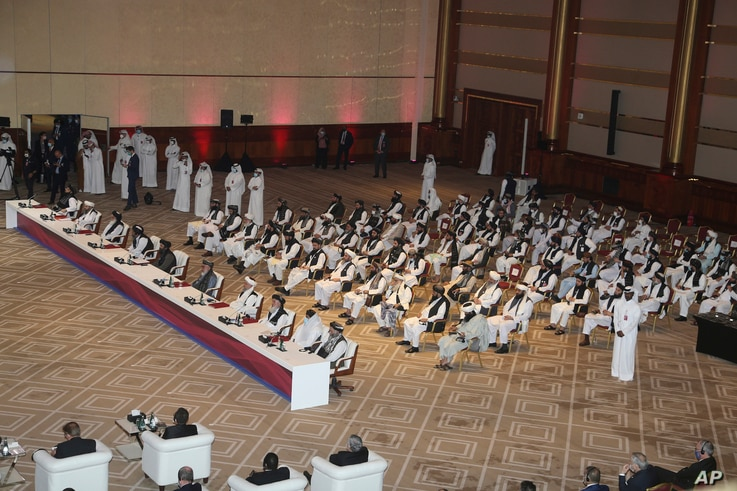 Taliban delegation attend the opening session of the peace talks between the Afghan government and the Taliban in Doha, Qatar,…