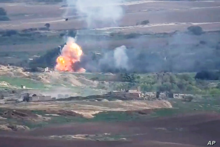 This image taken from a video released by Armenian Defense Ministry on Monday, Sept. 28, 2020 allegedly shows fighting between…