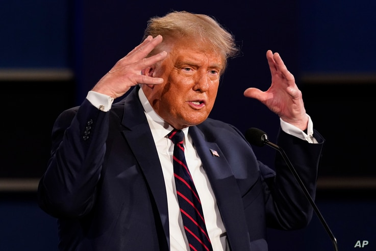 President Donald Trump gestures while speaking during the first presidential debate Tuesday, Sept. 29, 2020, at Case Western…