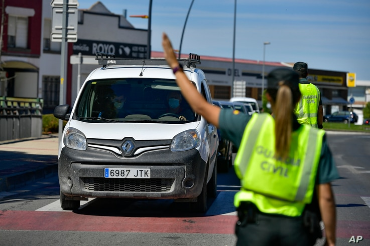 Spanish Civil Guards on a checkpoint for all residents of the small village of Alfaro, La Rioja Province, northern Spain,…