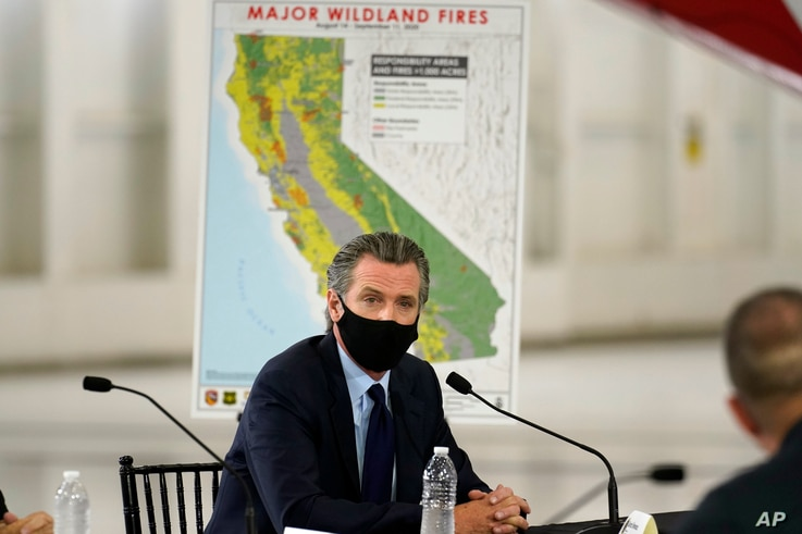 California Gov. Gavin Newsom listens during a briefing with President Donald Trump at Sacramento McClellan Airport, in…