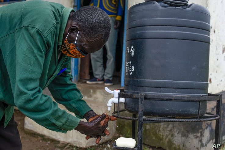 A trainee leaves class to wash his hands, at a training session for community health workers conducted by the national NGO …