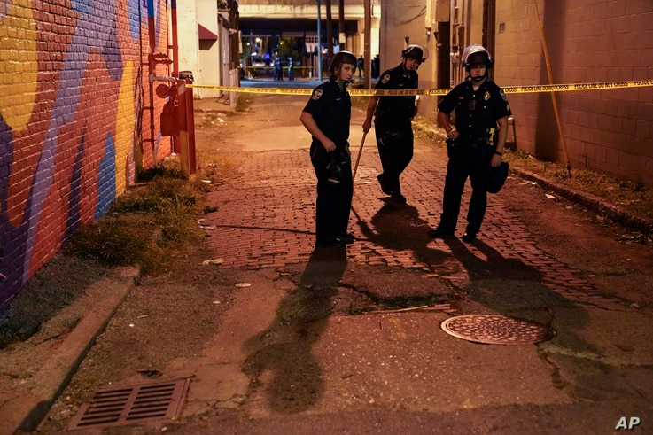 Police survey an area after a police officer was shot, Wednesday, Sept. 23, 2020, in Louisville, Ky. A grand jury has indicted…
