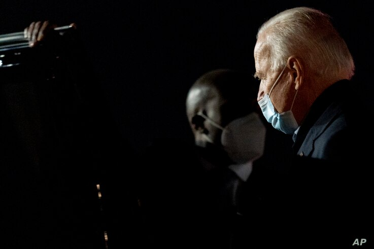 Democratic presidential candidate former Vice President Joe Biden arrives at New Castle Airport in New Castle, Del., Friday,…