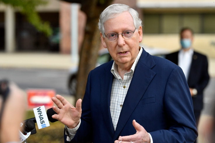 Senate Majority Leader Mitch McConnell, R-Ky., speaks to reporters after casting his vote in the 2020 general election at the…